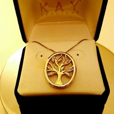 Family Tree Diamond Necklace Features the Tree of Life or Giving Tree pendant about the size of a quarter. Oval part has a baroque design to lift and tree is 10K gold with REAL diamonds put in the leaves. So beautiful I almost don't want to get rid of it!!! Kay Jewelers Jewelry Necklaces