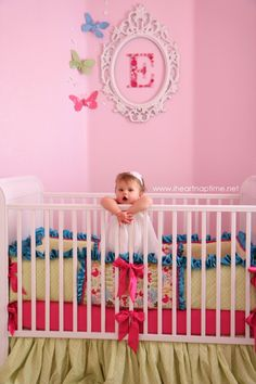 First letter of a baby's name in picture frame over the crib, super cute