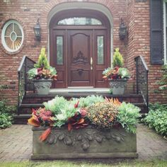 Fall container gardens.  Three more amazing fall arrangements on this web site. be sure and go to the site.