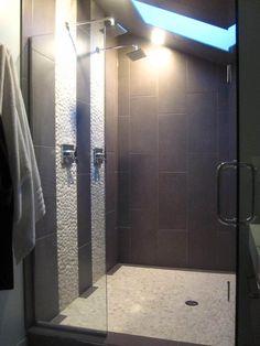 Rehabitual Homes   Dual head rain shower, River rock accent walls, Skylight shower  http://www.rehabitualhomes.com/rehabitual-homes-blog/13744522/showerlove#
