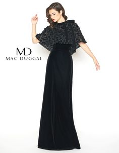 A high neckline, fitted, velvet, column dress with a floral embroidered caplet, featuring a neckline bow.