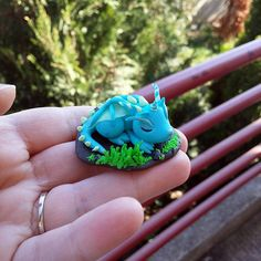 Cute baby dragon sleeping polymer clay figure