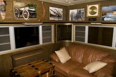 Photos on cabinet doors!  Great idea for a photographer's camper!