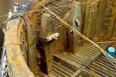 View of the corrosion-scarred turret of the USS Monitor.