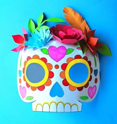 These cute and colorful masks are inspired by Mexican sugar skulls — a traditional sweet treat on Dia de Los Muertos. Kids will get super creative coloring them in and making the paper flower crowns.