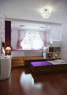 Ein Kinderzimmer mit Podest, das ein Rollbett versteckt