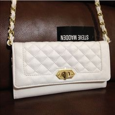 """NWT Steve Madden White Crossbody Wallet LAST ONE IN WHITE...NEW WITH TAGS, Steve Madden White Crossbody Wallet. Can be worn as a crossbody or remove the strap and use as a regular wallet!   • Dimensions: 7.5"""" x 4"""" with 50"""" removable strap • Interior: 10 credit card slots, 4 full length slip pockets for cash etc and 1 zip compartment • Exterior: 2 full length slip pockets and 1 zipper compartment  • Gold tone hardware  I have more STEVE MADDEN for sale, check out my other items!  ❌NO TRADES…"""