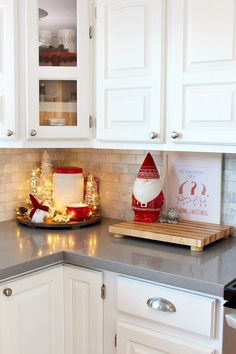 White kitchen with cute Christmas gnome cookie jar all decorated for Christmas in red and white. decor simple Christmas Kitchen Decor - Clean and Scentsible Classy Christmas, Cozy Christmas, Rustic Christmas, White Christmas, Christmas Ideas, Christmas Mantels, Victorian Christmas, Christmas Decorating Ideas, Vintage Christmas