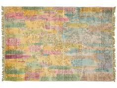 Pure shades of puce, amber, and aquamarine blur into blue spectrums in this one-of-a-kind vintage rug
