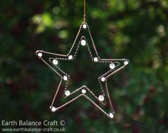 Little Stars Hanging Decoration - A rustic polished and weathered copper star shaped hanging ornament with frosted crackle glass beads.