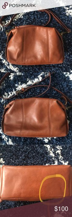 Madewell Mini Glasgow Crossbody Bag Beautiful and perfectly classic Madewell Mini Glasgow Crossbody Bag in English Saddle. Wonderfully soft leather.   Slight wear on the bottom and top corners. There's a water spot on the bottom (circled in the photo). Interior clean.   Leather treated with leather weather guard.   Please see photos for condition, details, and styling. Madewell Bags Crossbody Bags