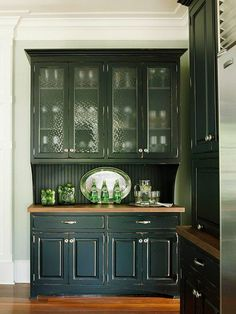 Idea for a top for the buffet. Love the black distressed cabinets glazed with red and the polka-dot glass panels
