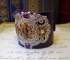 leather steampunk wristcuff? i'll take two (one in this fabulous purple, and one in a dusty teal, please)!