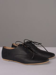 pSimple black leather oxford shoe with thin leather cord laces, a natural leather interior, single-stack micro-heel, and matching black sole. Made in Italy./p