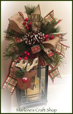Rustic Christmas Swag, Cabin decoration, Northwoods, Hunting Lodge Decoration, Man Cave Christmas Decoration, Reindeer Swag. This whimsical reindeer theme Christmas Tree topper/ Lantern Swag / Lantern Bow/Wreath accent bow is pictured on a 14in Lantern. The lantern swag features a
