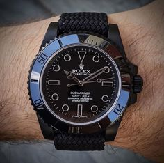 All black Rolex Submariner on matching perlon strap⚫️ this is one of my favorite rolexes. Would you wear this? Tag a Rolex Lover! What's your ideal wrist game? -------- Watch Strap via Watch Custom made by Rolex Watches For Men, Gents Watches, Luxury Watches For Men, Cool Watches, Elegant Watches, Beautiful Watches, Black Rolex, High End Watches, Rolex Submariner