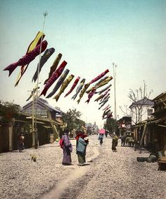 """koi nobori"" in old yokahama, japan - wind-sock carp feeding on the breeze during a BOY'S DAY festival in May by okinawa soba, via Flickr"