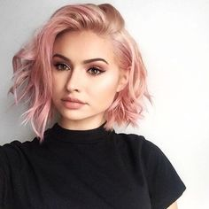 wavy bob hairstyle with pastel pink hair