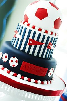 SPORTS PARTY theme idea red white and blue fondant soccer ball top tier birthday cake with striped layers 3 tiered