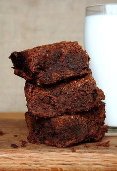 """""""Naughty Brownies."""" Use this brownie recipe. I've actually made these brownies. They're amazing, the perfect texture of cakey/chewy/fudgy, and don't require a double boiler. Then spread about an 1/8"""" of blackberry jam on top of the finished pan and seal it with Black Velvet frosting (also on the site, 1/3rd the recipe). They certainly are Naughty Brownies: I ate the whole damn pan."""
