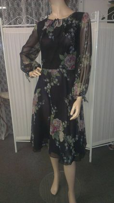 Check out this item in my Etsy shop https://www.etsy.com/listing/209520020/1970s-floral-chiffon-cocktail-dress