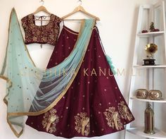 Beautiful maroon color lehenga and designer blouse with powder blue net duppata from Geethika Kanumilli.