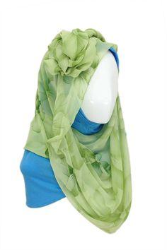 Green Flower Hijab Hijab description  Hijab Material: Chiffon Hijab Color: Green Underscarf Material: Rayon Jersey Knit Underscarf Color: Blue http://hijabila.com/product/green-flower-hijab/