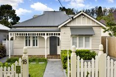 Front verandah decking, stepping stones across the grass and fretwork.