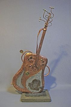 Steampunk Guitar Sculpture  - would be great for the Steampunk office/music room