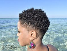 Ladies Kuts By Short to the sides with V outline at back rocking a natural curly top on a beauty beach in The Bahamas Big up: Thanks to Model: Short Natural Styles, Natural Hair Short Cuts, Short Natural Haircuts, Short Hair Cuts, Natural Hair Twa, Short Styles, Short Hair Undercut, Short Curly Hair, Curly Hair Styles