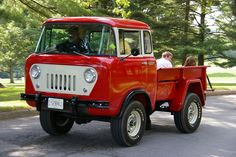 Cute red truck. Jeep Forward Control.