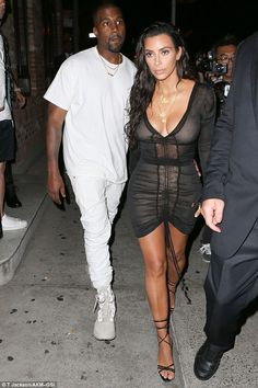 The happy couple: Kim Kardashian and Kanye West looked downcast as they departed the MTV VMAs in New York on Sunday night for a night out with Beyonce and Jay Z, following Kanye's double loss and rambling speech at the show