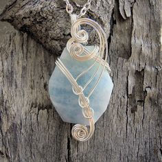 Aquamarine Wire Wrapped Pendant Necklace in Silver by Care More Creations.  Aquamarine is the birthstone for March, $38.00