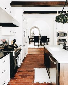 I love the brick-like floors and the white paired with the darker accents. Brick Flooring, Floors, Kitchen Flooring, Farmhouse Furniture, Farmhouse Kitchen Decor, Diy Kitchen, Decorating Ideas, Decor Ideas, Kitchen Island