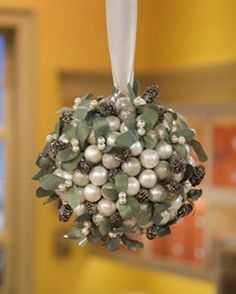 Glittering Mistletoe Ball: Silver floral spray paint, glitter, and small pinecones create a magnificent effect when combined on this mistletoe ball. by caroline All Things Christmas, Winter Christmas, Christmas Holidays, Christmas Wreaths, Christmas Ornaments, Christmas Ideas, Christmas Balls, Xmas, Holiday Crafts