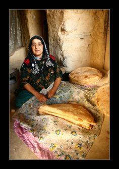Kurdish Woman at baking fresh brotes, near Paveh, Province Kirmaşan, Iran.
