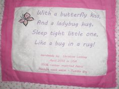 Label on back of pink baby quilt.