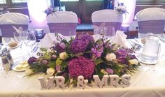 top-table-centrepiece-purple-hydrangea-cream-roses.jpg 881×522 pixels