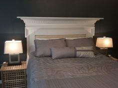 Antique fireplace mantel repurposed to a padded headboard.  My master bedroom.