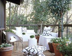 big terracotta pots & comfy cushions