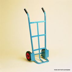 First Class heavy duty hand truck on 20cm wheels. 15cm long foot iron. Blue enamelled steel construction capacity.