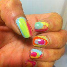 My Crazy summer nails DIY Just added  random stripes n patterns !! My first attempt so a little messy ! Can add a crackle for a rainbow effect !