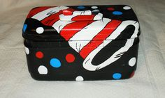 Dr. Seuss cat in the hat upcycled train case suitcase, I found this really awesome Etsy listing at https://www.etsy.com/listing/230300364/refinished-handmade-hand-painted-dr