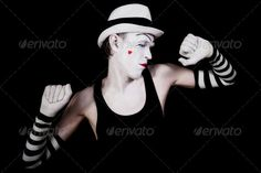dancing mime in white hat (artistic, background, black, caucasian, celebration, circus, closed, clown, dancing, drama, emotional, emotions, entertainment, eyes, face, fun, funny, gesticulation, gesture, gloves, grimace, hand, hands, hat, heart, hilarious, humor, isolated, makeup, male, man, mask, mime, one, open, paint, pantomime, performance, person, portrait, red, screaming, shouting, striped, studio, theater, white, young)