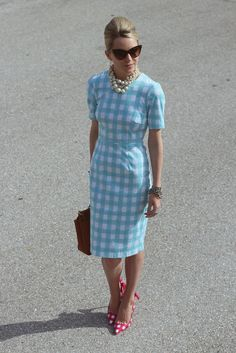 Work Wardrobe. Bit of retro glam with light blue checkered fitted dress with sleeves. Worn with pearl necklaces, pointy sunglasses and tan bag. Spring, Summer.