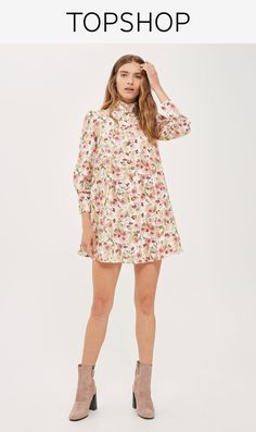 Invigorate your dress options with this high neck shirt dress. Design features include a ruffle high neck, three-quarter puff sleeves and long cuffs.