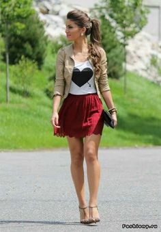 cream leather jacket white t-shirt with black heart red highwaisted skirt. tan gimchoes .