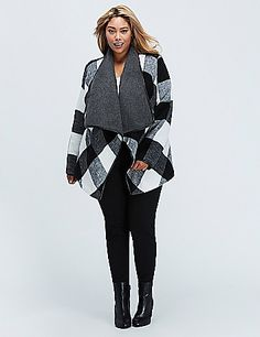 We consider the blanket coat the anti-jacket (but with all the warmth). Pockets. Faux leather trim. lanebryant.com