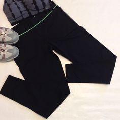 "Lorna Jane workout capris. 27"" inseam 9"" uprise 15-18"" waist with 2"" waistband 4"" leg opening. Bright green piping with green inner drawstring Lorna Jane Pants Capris"