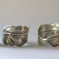 Silver feather ring.